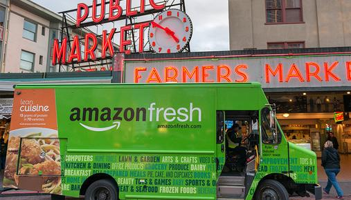 https://tickertapecdn.tdameritrade.com/assets/images/pages/md/AmazonFresh delivery truck in Seattle