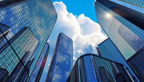 https://tickertapecdn.tdameritrade.com/assets/images/pages/md/Tall office skyscrapers and blue sky