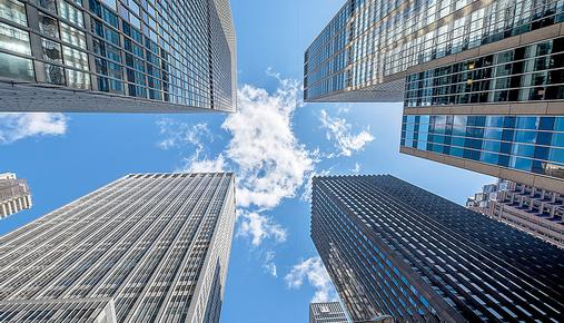 https://tickertapecdn.tdameritrade.com/assets/images/pages/md/Looking up at tall skyscrapers
