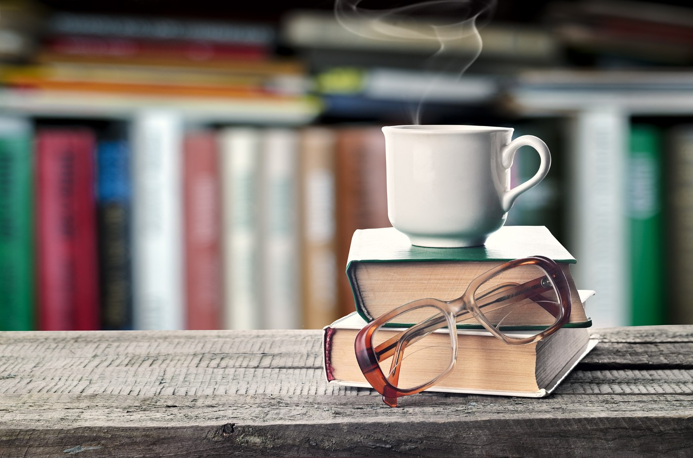 https://tickertapecdn.tdameritrade.com/assets/images/pages/md/Two books, cup of coffee, and glasses: Classic investing books to add to your reading list for better trading