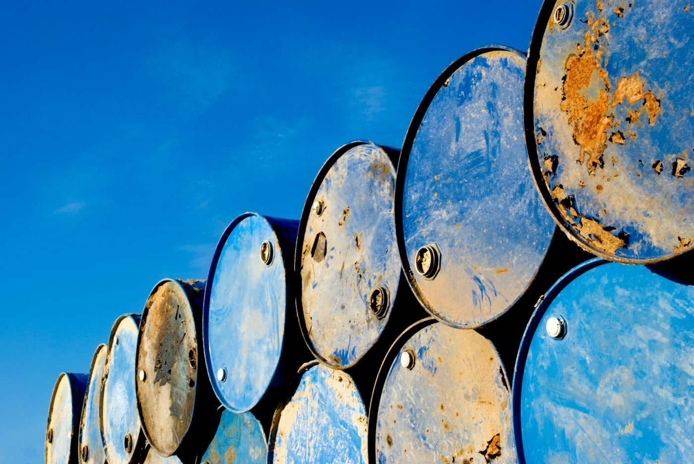 https://tickertapecdn.tdameritrade.com/assets/images/pages/md/Oil barrels stacked against a bright blue sky: Crude oil may reach $100/barrel
