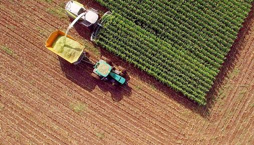 https://tickertapecdn.tdameritrade.com/assets/images/pages/md/Overhead view of farm tractor harvesting corn
