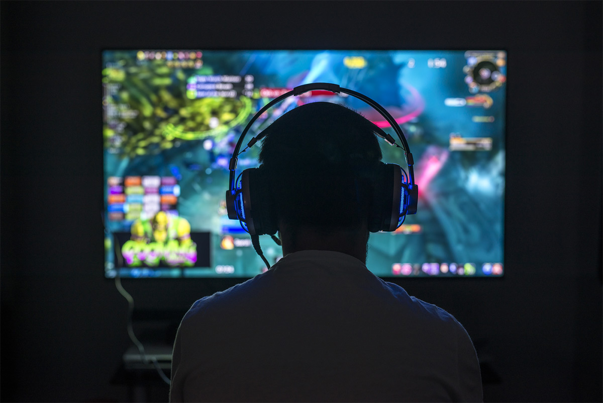 https://tickertapecdn.tdameritrade.com/assets/images/pages/md/Gamer playing video games with headset on