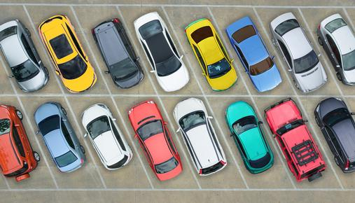 https://tickertapecdn.tdameritrade.com/assets/images/pages/md/Overhead view of a row of cars parked in a parking lot