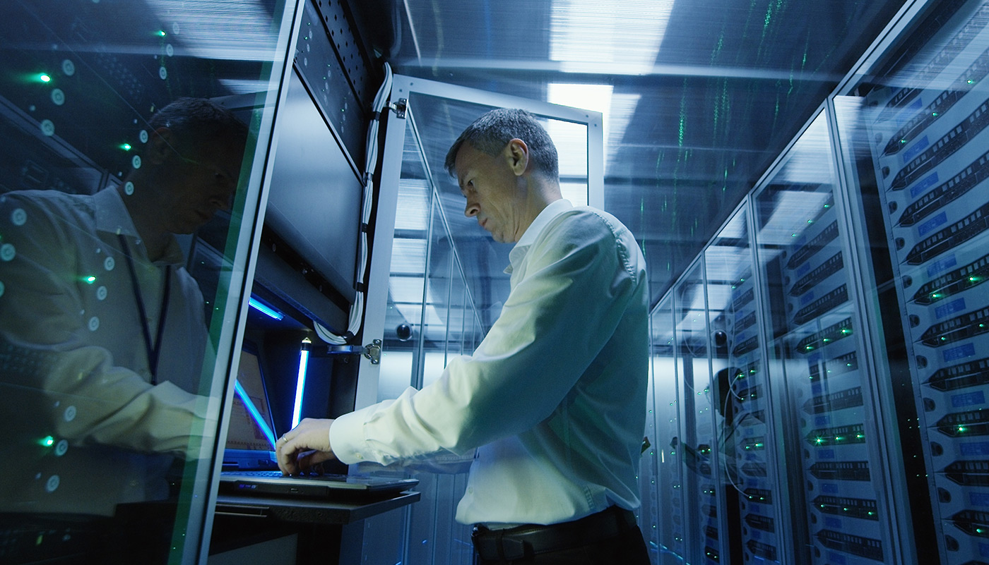 https://tickertapecdn.tdameritrade.com/assets/images/pages/md/Man working in a server room