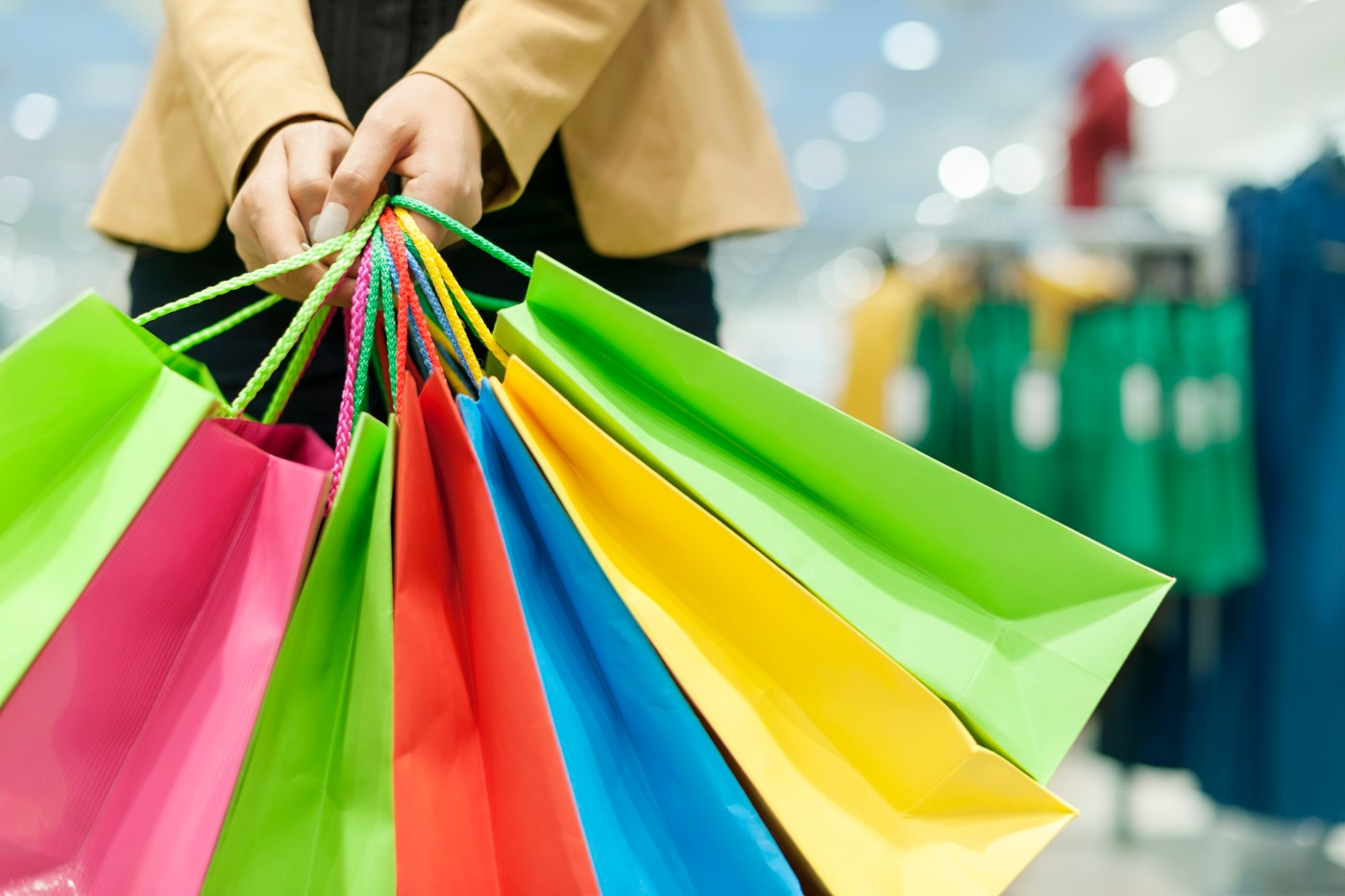 https://tickertapecdn.tdameritrade.com/assets/images/pages/md/Person with many shopping bags: CPI, GDP, and jobs report indicate strength of U.S. economy