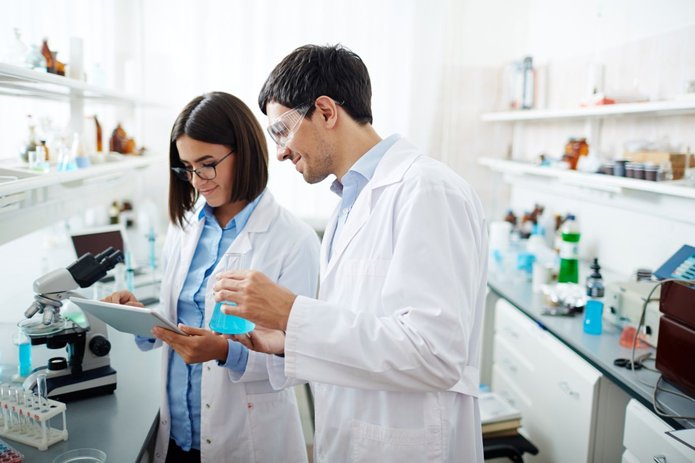 https://tickertapecdn.tdameritrade.com/assets/images/pages/md/Two people working in a pharmaceutical lab