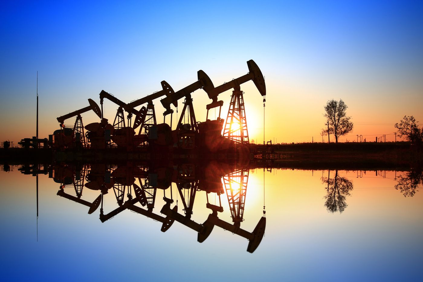 https://tickertapecdn.tdameritrade.com/assets/images/pages/md/Oil wells operating in front of sunset