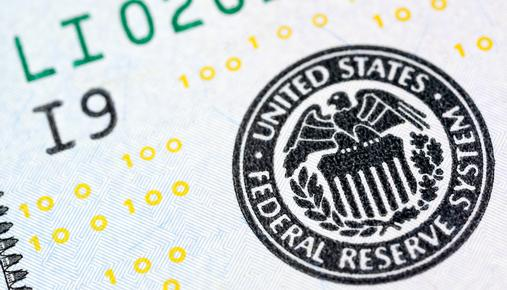 https://tickertapecdn.tdameritrade.com/assets/images/pages/md/Federal Reserve System Seal on Dollar Bill