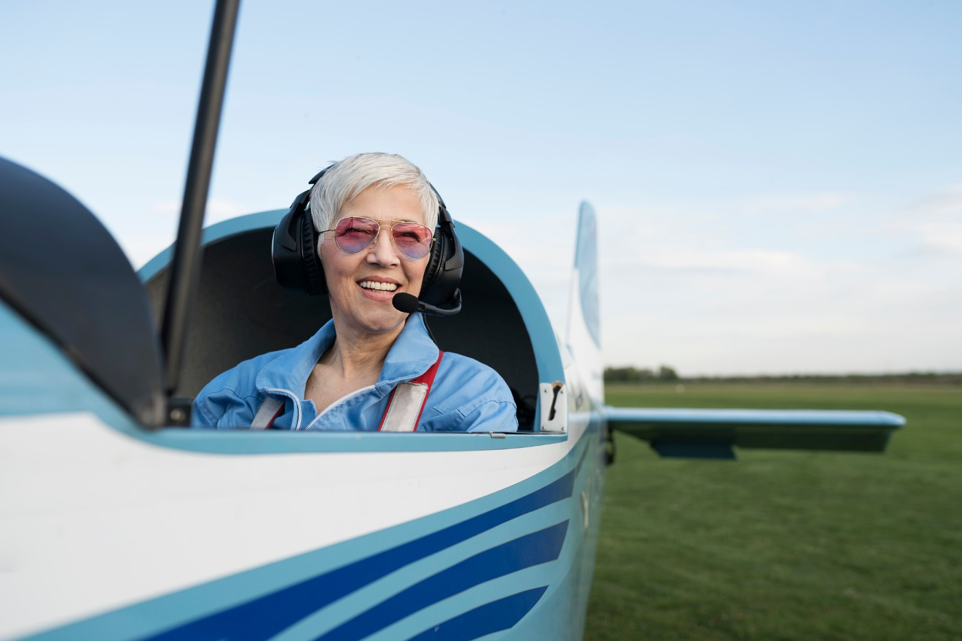 https://tickertapecdn.tdameritrade.com/assets/images/pages/md/Older white woman in propeller plane: Flying solo with finances
