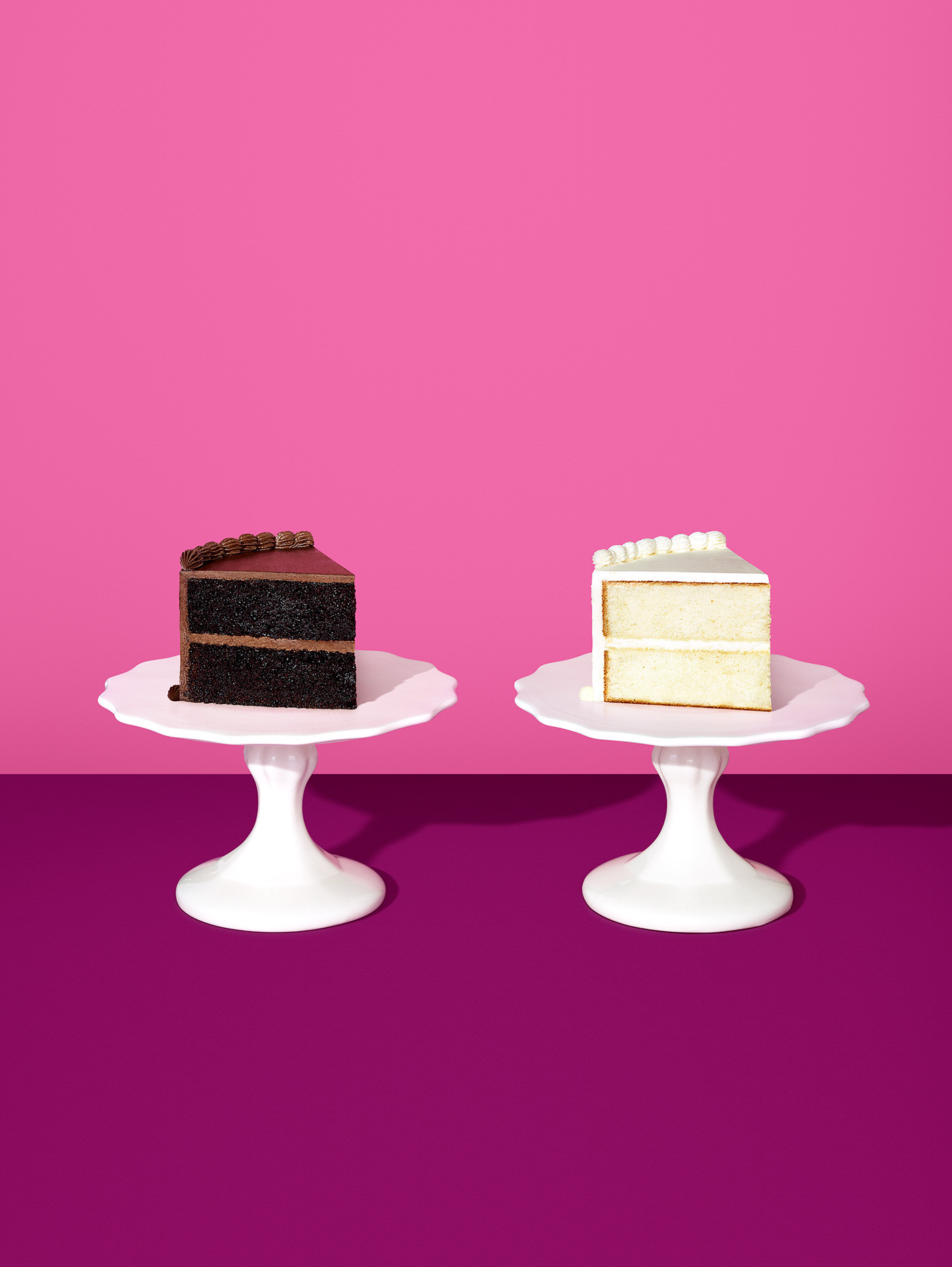 https://tickertapecdn.tdameritrade.com/assets/images/pages/md/One chocolate one vanilla piece of cake on two respective white raised platters