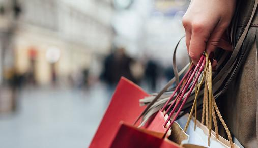 https://tickertapecdn.tdameritrade.com/assets/images/pages/md/Person holding several shopping bags