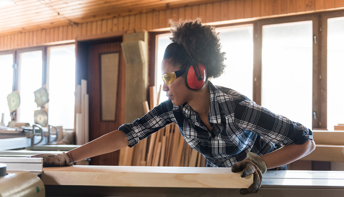 https://tickertapecdn.tdameritrade.com/assets/images/pages/md/Woman working in carpenter workshop