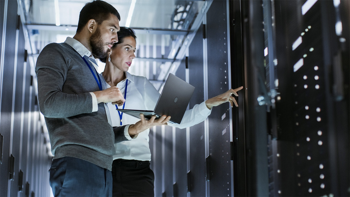 https://tickertapecdn.tdameritrade.com/assets/images/pages/md/Man and woman working in a server room