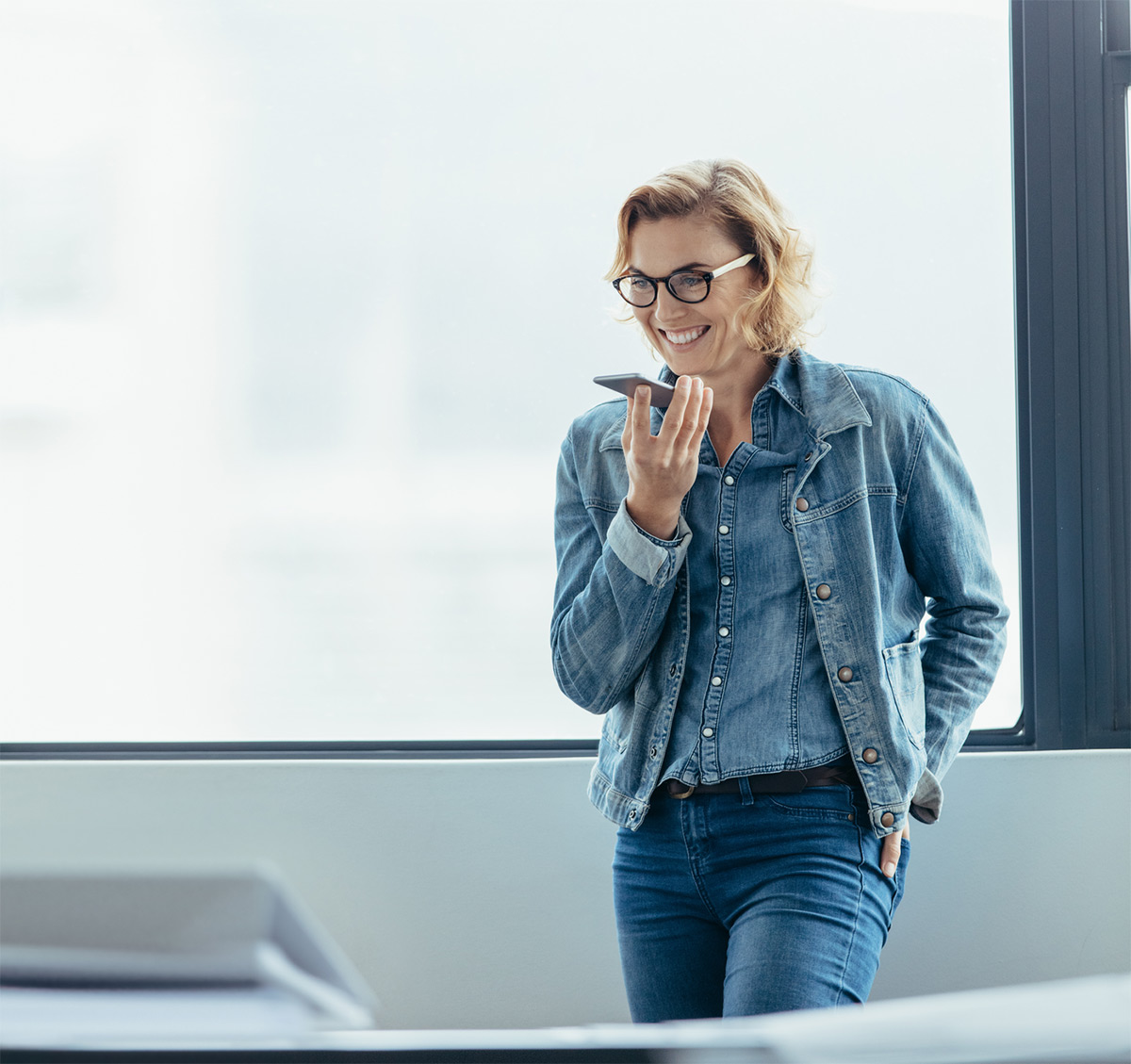 https://tickertapecdn.tdameritrade.com/assets/images/pages/md/Woman talking on smartphone