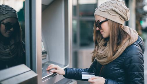https://tickertapecdn.tdameritrade.com/assets/images/pages/md/Woman withdrawing money from a bank ATM