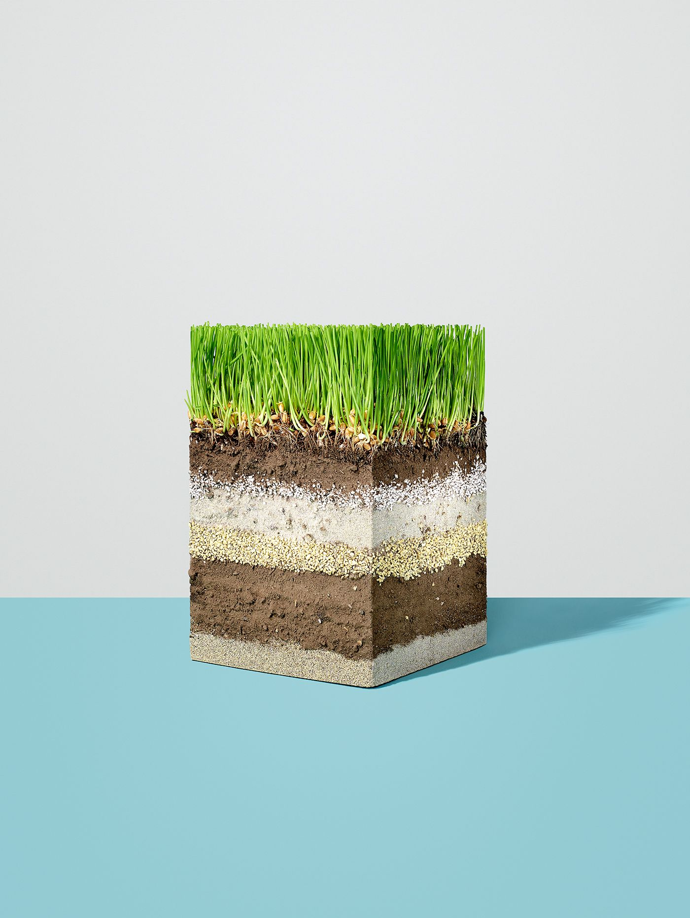 https://tickertapecdn.tdameritrade.com/assets/images/pages/md/Crosscut of soil and minerals with a patch of grass growing on it