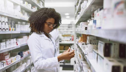 https://tickertapecdn.tdameritrade.com/assets/images/pages/md/Woman working in pharmaceutical counter