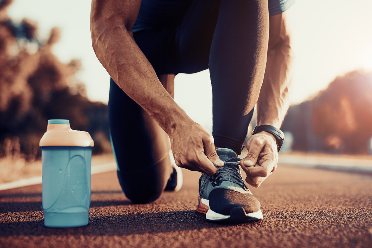 https://tickertapecdn.tdameritrade.com/assets/images/pages/md/Man tying running shoe