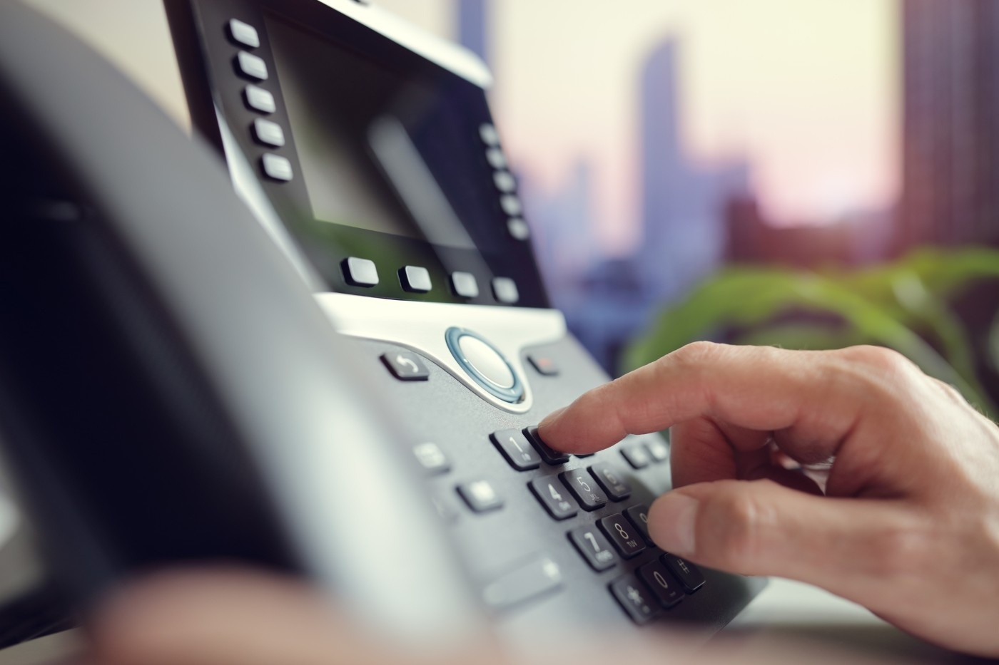 https://tickertapecdn.tdameritrade.com/assets/images/pages/md/Hand dialing on a business phone: Quarterly earnings calls
