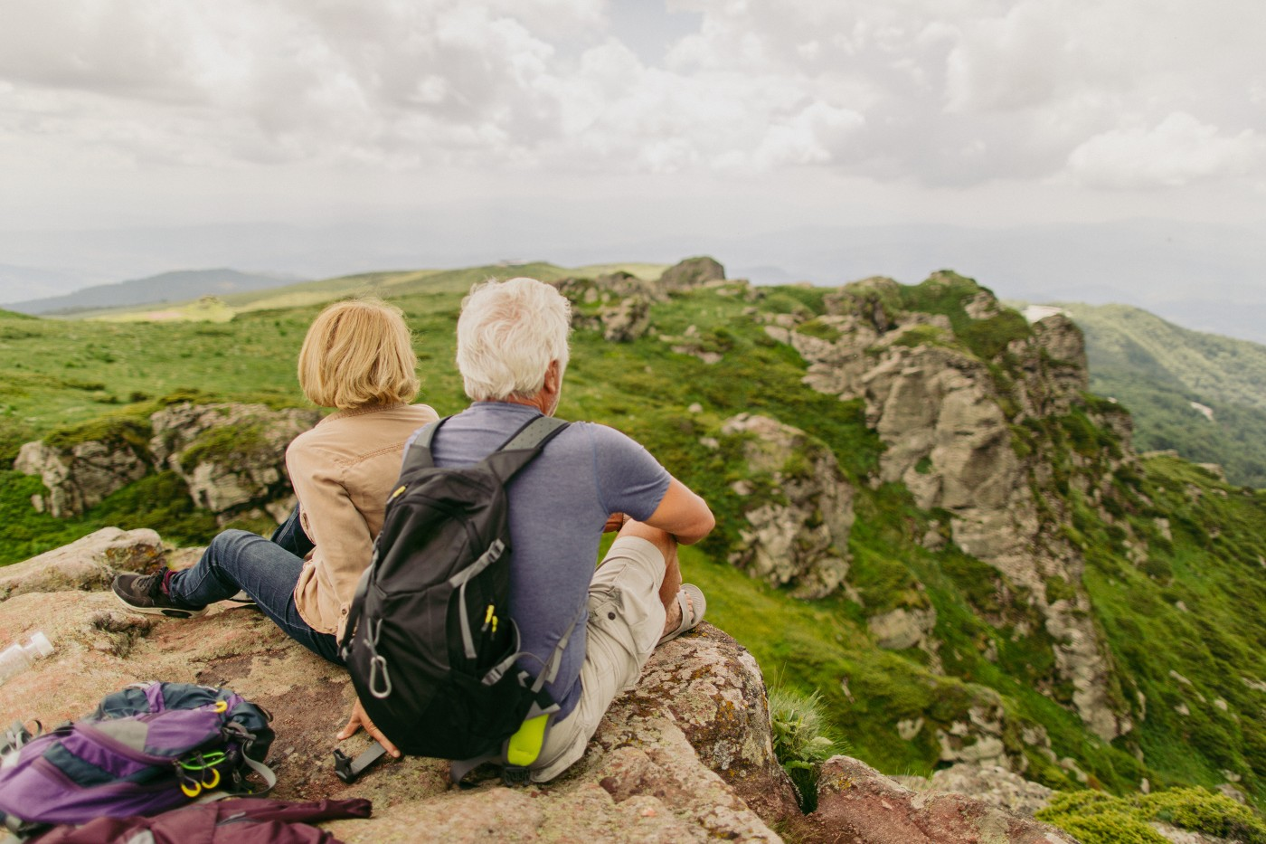 https://tickertapecdn.tdameritrade.com/assets/images/pages/md/Older woman and man on a hike: Careful planning to achieve retirement dreams