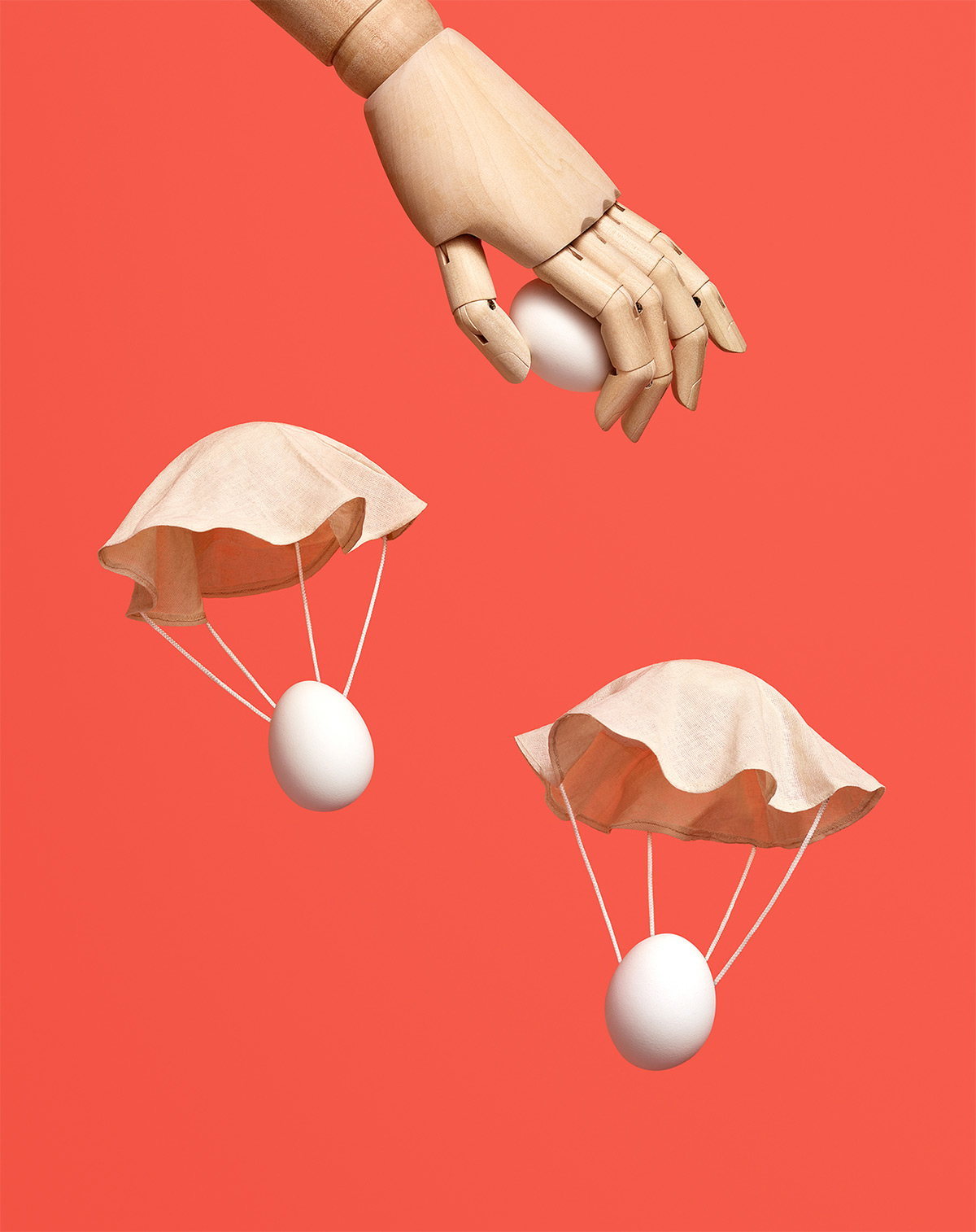 https://tickertapecdn.tdameritrade.com/assets/images/pages/md/Wooden hand dropping eggs on parachutes