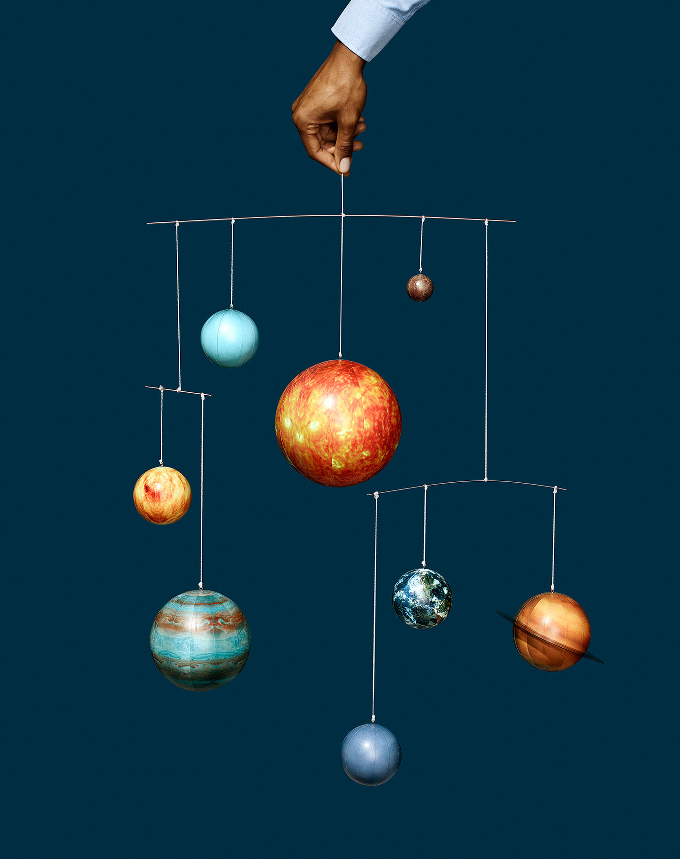 https://tickertapecdn.tdameritrade.com/assets/images/pages/md/Solar system mobile held by a hand