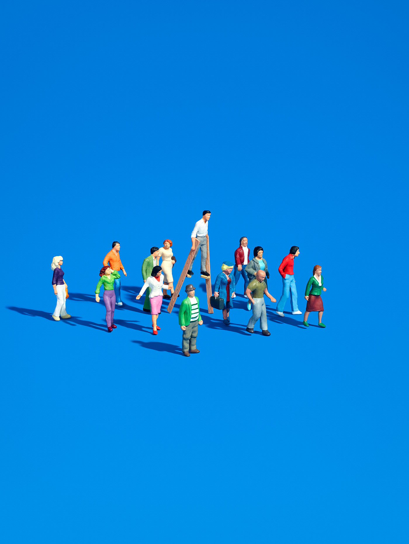 https://tickertapecdn.tdameritrade.com/assets/images/pages/md/Crowd of miniature people moving in one direction with a figure walking in stilts leading the way
