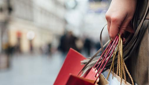 https://tickertapecdn.tdameritrade.com/assets/images/pages/md/Shopper holding several shopping bags