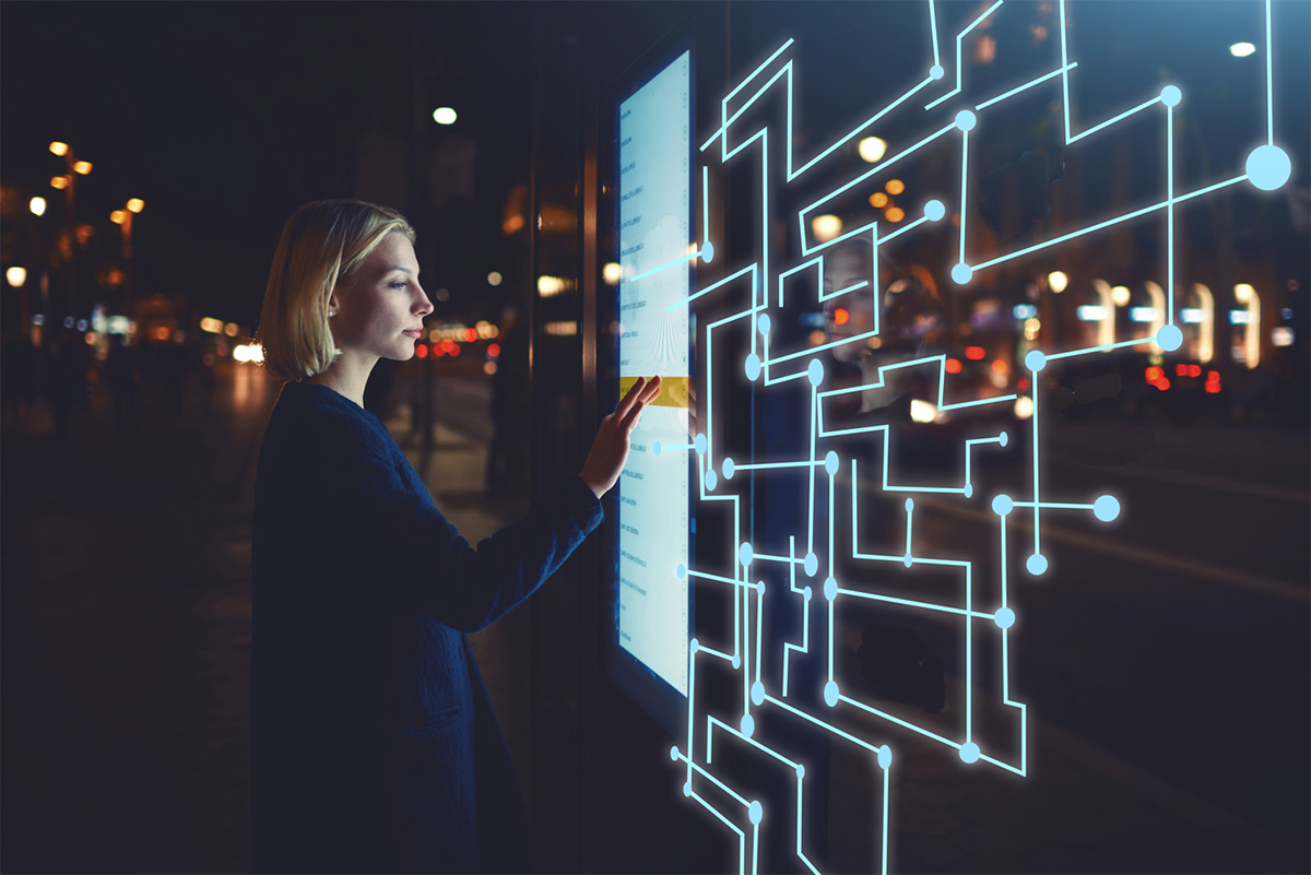 https://tickertapecdn.tdameritrade.com/assets/images/pages/md/Woman using touchscreen technology