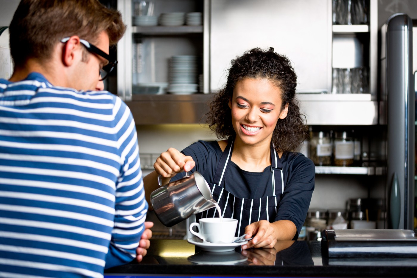 https://tickertapecdn.tdameritrade.com/assets/images/pages/md/Teen girl working as a barista: Financial lessons teens can learn from summer jobs