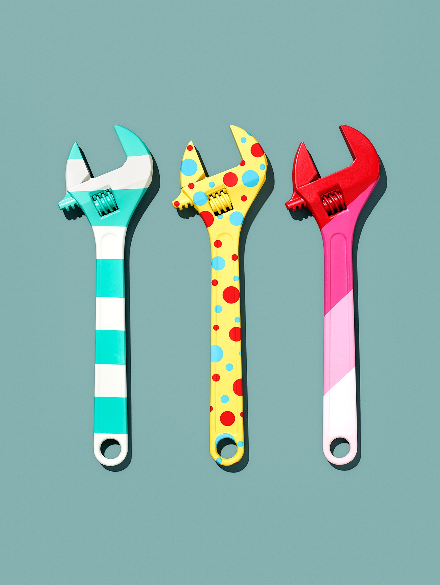 https://tickertapecdn.tdameritrade.com/assets/images/pages/md/Three identical adjustable wrenches all painted in different patterns, small stripes, polka dots, and multicolor
