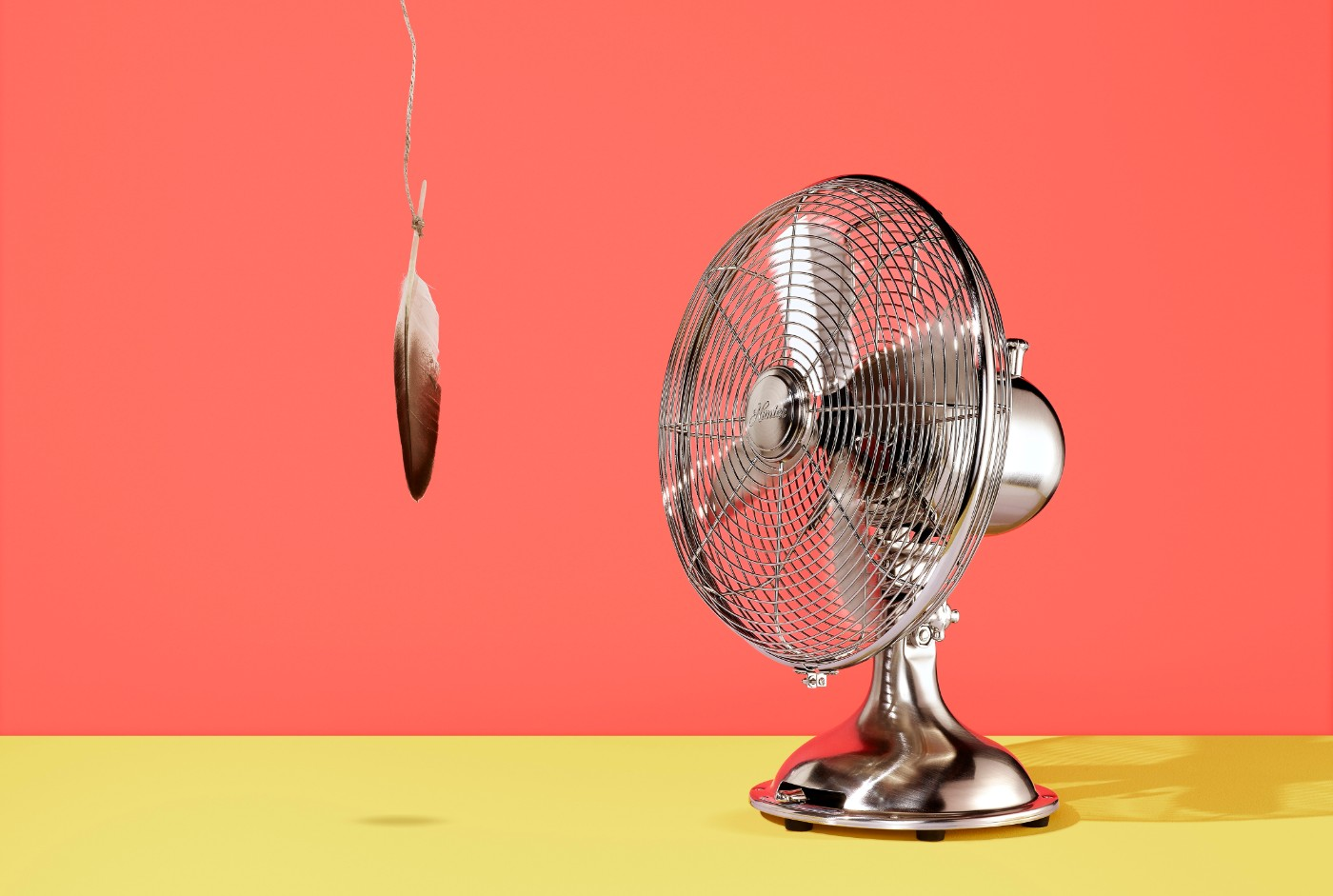 https://tickertapecdn.tdameritrade.com/assets/images/pages/md/A fan not turned on with a feather hanging on a string right in front of it