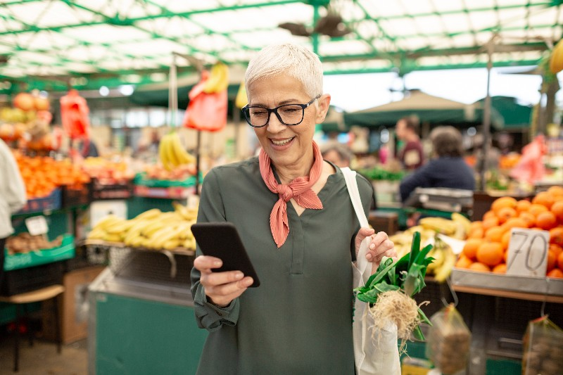 Senior woman shopping in a grocery store: Required minimum distributions (RMD)